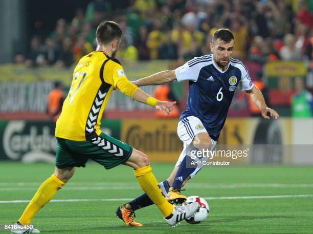Scotland's James McArthur vies with Lithuania's Mantas Kuklys during the FIFA World Cup 2018 qualification football match between Lithuania and...