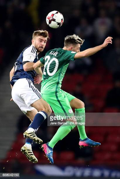 Scotland's James Morrison and Slovenia's Kevin Kampl battle for the ball during the World Cup Qualifying match at Hampden Park Glasgow