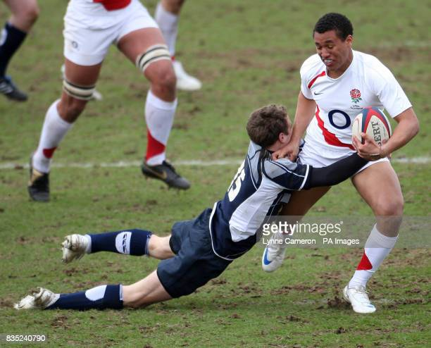 Scotland's Jamie Forbes tries to stop England's Marcus Watson during the Under 18 International match at Kingston Park Newcastle