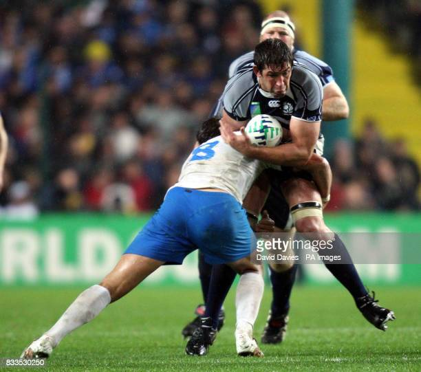 Scotland's Jim Hamilton is tackled by Italy's Sergio Parisse during the IRB Rugby World Cup Pool C match at Stade GeoffroyGuichard St Etienne France