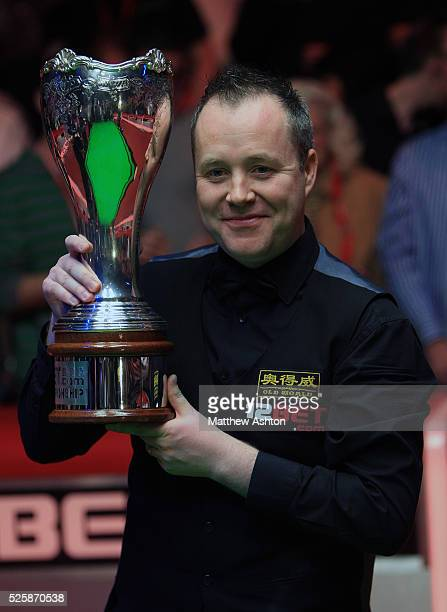Scotland's John Higgins with the UK Championship trophy after winning the 12BetCom UK Championship with a 10 frames to 9 victory over Mark Williams
