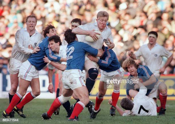 Scotland's John Jeffrey is tackled by France's Franck Mesnel while Scotland's Anthony Stanger blocks French Philippe Sella during a Five Nations...