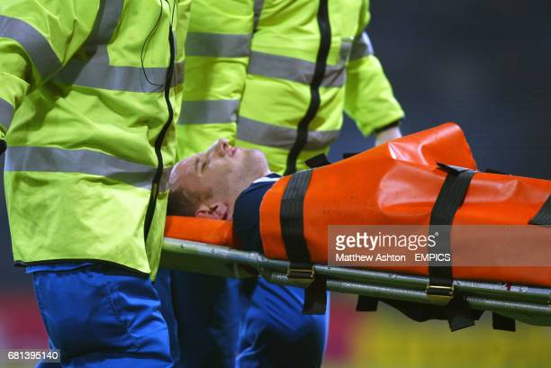 Scotland's John Kennedy is carried from the field on a stretcher after picking up an injury