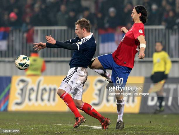 Scotland's Jordan Rhodes challenges Serbia's Neven Subotic during the FIFA World Cup Qualifying Group A match at Karaorde Stadium Novi Sad Serbia