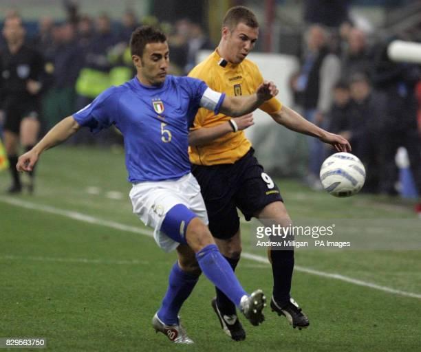 Scotland's Kenny Miller challenges Italy's Fabio Cannavaro