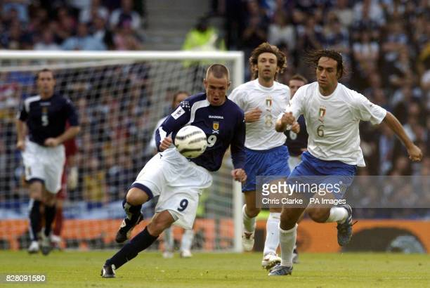 Scotland's Kenny Miller goes past Italy's Alessandro Nesta during the World Cup qualifier at Hampden Park Glasgow Saturday September 3 2005 PRESS...