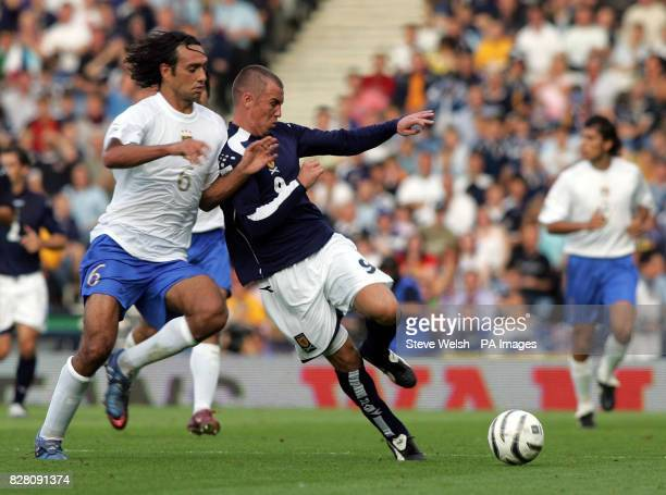 Scotland's Kenny Miller holds off Italy's Alessandro Nesta during the World Cup qualifier at Hampden Park Glasgow Saturday September 3 2005 PRESS...