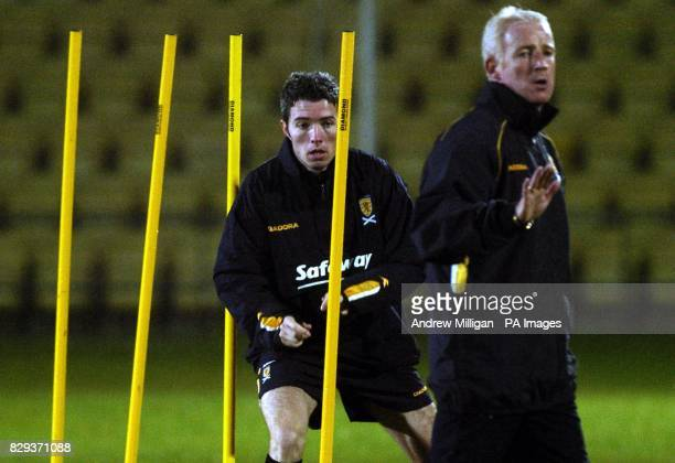 Scotlands Kevin McNaughton and caretaker manager Tommy Burns during Scotland training at the Strathclyde Homes Stadium in Dumbarton prior to the...