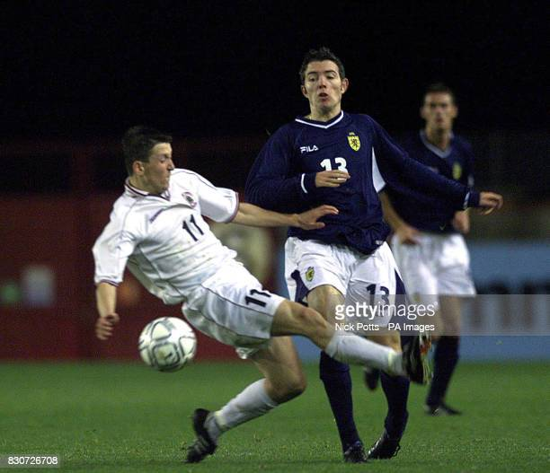 Scotland's Kevin McNaughton avoids the late tackle from Latvia's Romans Bezzubovs during the European Under 21 Championship group six qualifying...