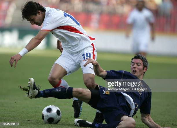 Scotland's Kevin McNaughton challenges the Czech Republic's Rudi Skacel during the International Friendly match at the Spartan Stadium in Prague...