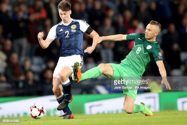 Scotland's Kieran Tierney and Slovenia's Jasmin Kurtic battle for the ball during the World Cup Qualifying match at Hampden Park Glasgow