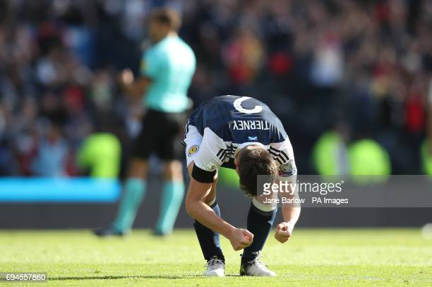 Scotland's Kieran Tierney appears dejected after the final whistle during the 2018 FIFA World Cup qualifying Group F match at Hampden Park Glasgow
