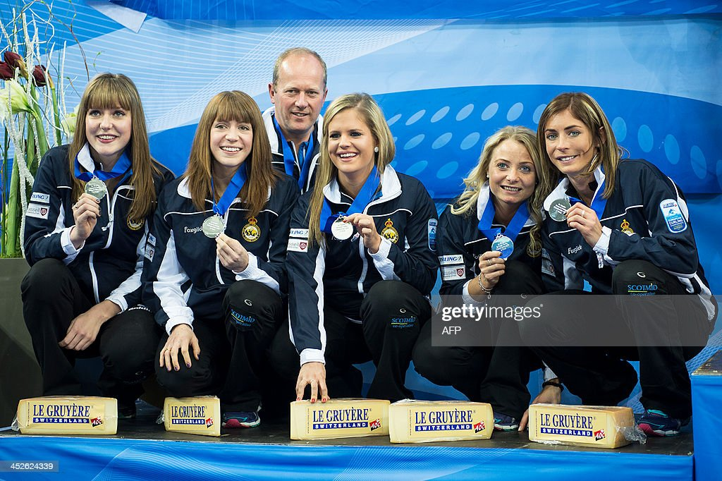Scotland's Lauren Gray, Claire Hamilton, coach David Hay, Vicki Adams, Anna Sloan and Eve Muirhead pose with their silver medals after placing second in the women's European Curling Championships in Stavanger, Norway, on November 30, 2013. AFP PHOTO /NTB scanpix/ CARINA