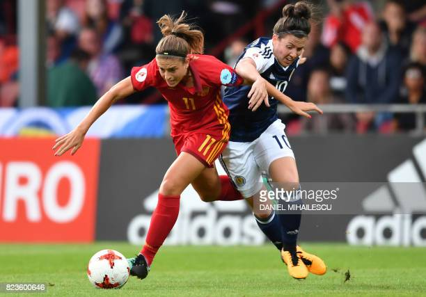 Scotland's Leanne Crichton vies with Spain's Alexia Putellas during the UEFA Women's Euro 2017 football match between Scotland and Spain at De...