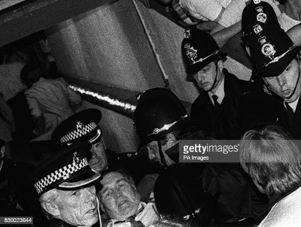 Scotland's legendary soccer manager Jock Stein being carried from the touchline by police after he collapsed and died as the final whistle blew on...