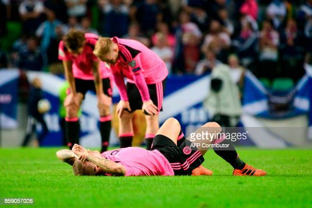 Scotland's Leigh Griffiths Charlie Mulgrew and Barry Bannan react after their draw during the FIFA World Cup 2018 qualifier football match between...