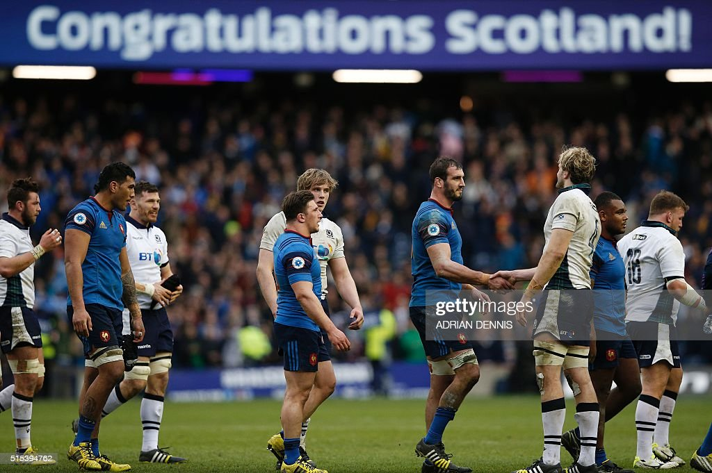 Scotland's lock Jonny Gray (R) shakes hands with France's lock Yoann Maestri following the Six Nations international rugby union match between Scotland and France at Murrayfield in Edinburgh, Scotland on March 13, 2016. Scotland won the match 29-18. / AFP / ADRIAN