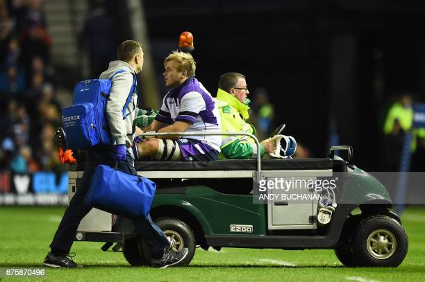 Scotland's Luke Hamilton goes off injured during the international rugby union test match between Scotland and New Zealand at Murrayfield stadium in...