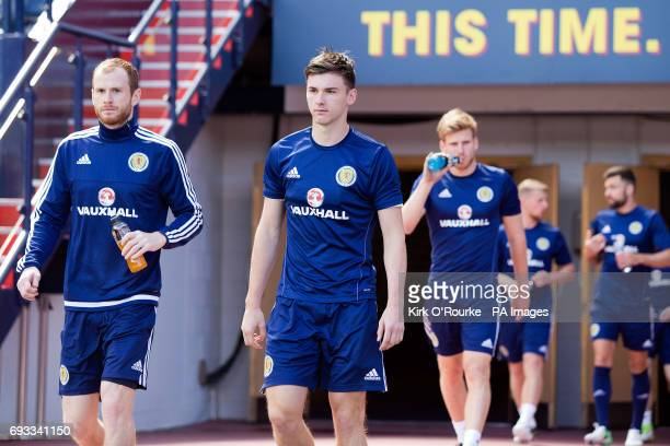 Scotland's Mark Reynolds and Kieran Tierney walk out for the training session at Hampden Park Glasgow