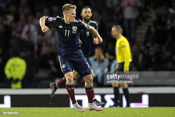 Scotland's Matt Ritchie celebrates scoring his team's first goal during the UEFA Euro 2016 qualifying Group D football match between Scotland and...
