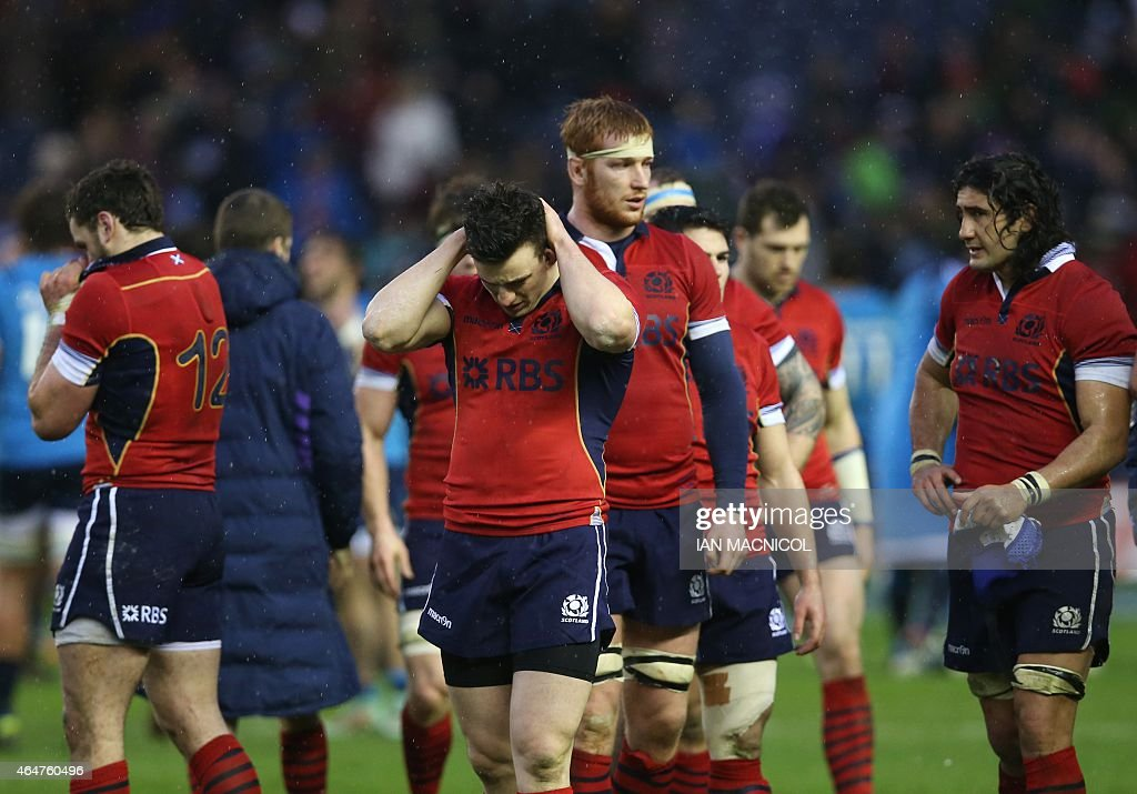 Scotland's <a gi-track='captionPersonalityLinkClicked' href=/galleries/search?phrase=Matt+Scott+-+Rugby+Union+Player&family=editorial&specificpeople=15066775 ng-click='$event.stopPropagation()'>Matt Scott</a> (3rd L) and Scotland players react at full time in the Six Nations international rugby union match between Scotland and Italy at Murrayfield in Edinburgh, Scotland on February 28, 2015. Italy won the game 22-19. AFP PHOTO / IAN MACNICOL