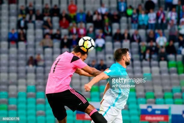 Scotland's Matthew Phillips heads the ball next to Bojan Jokic of Slovenia during the FIFA World Cup 2018 qualifier football match between Slovenia...