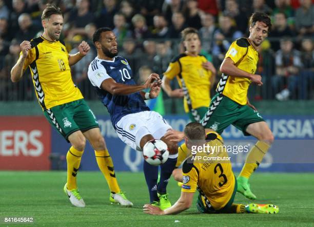 Scotland's Matthew Phillips vies with Lithuania's Arturas Zulpa and Georgas Freidgeimas during the FIFA World Cup 2018 qualification football match...
