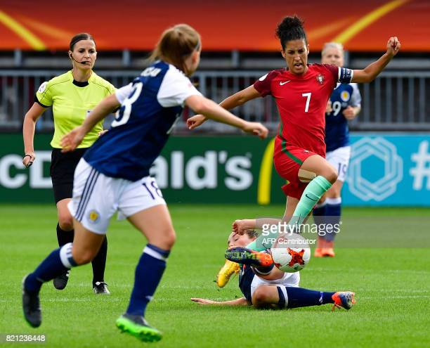 Scotland's midfielder Caroline Weir tackles Portugal's midfielder Claudia Neto during the UEFA Women's Euro 2017 football tournament between Scotland...