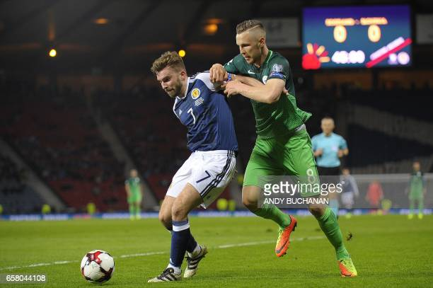 Scotland's midfielder James Morrison vies with Slovenia's midfielder Jasmin Kurtic during the World Cup 2018 qualification football match between...