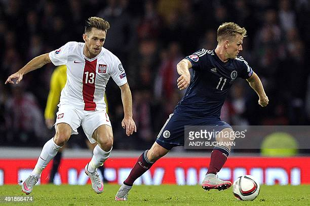 Scotland's midfielder Matt Ritchie runs with the ball in front of Poland's midfielder Maciej Rybus during the UEFA Euro 2016 qualifying Group D...