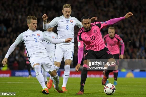 Scotland's midfielder Matthew Phillips vies with Slovakia's defender Peter Pekarik and Slovakia's midfielder Ondrej Duda during the FIFA World Cup...