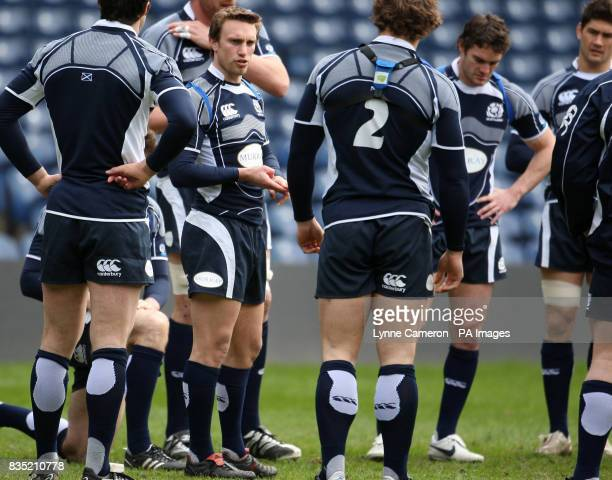 Scotland's Mike Blair speaks with team mates during the Captain's Run at Murrayfield Edinburgh