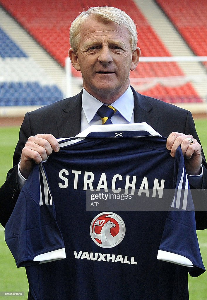 Scotland's new football manager Gordon Strachan poses with a jersey bearing his name following the announcement of his appointment in Glasgow on January 15, 2013. Strachan, a former Scotland midfielder, had long been the favourite to replace Craig Levein, who was sacked in November after a poor start to a World Cup qualifying campaign left Scotland's hopes of playing at Brazil 2014 in tatters.