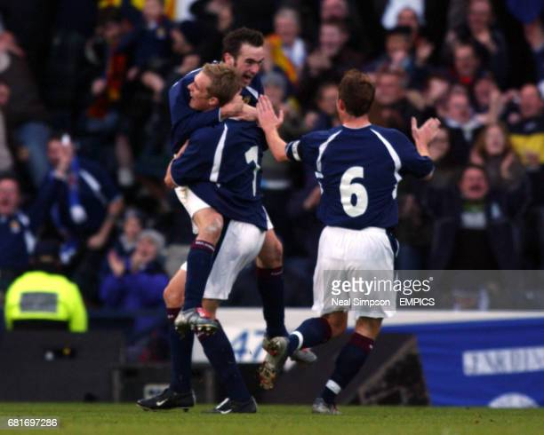 Scotland's opening goalscorer James McFadden celebrates with Darren Fletcher as Barry Ferguson runs to join in