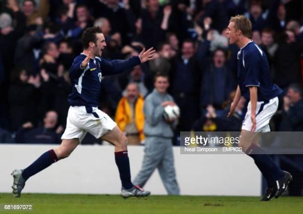 Scotland's opening goalscorer James McFadden celebrates with teammate Darren Fletcher