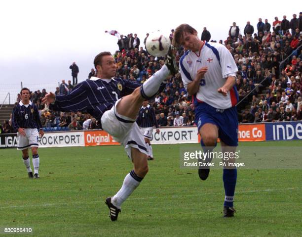 Scotland's Paul Dickov challenges Jon Roi Jacobsen of the Faroe Islands during the Euro 2004 qualifier in Toftir