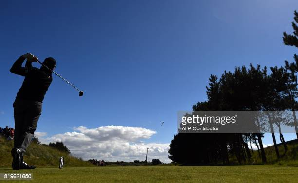 Scotland's Paul Lawrie plays from the 6th tee during his opening round on the first day of the Open Golf Championship at Royal Birkdale golf course...