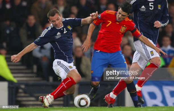 Scotland's Phil Bardsley and Spain's David Villa in action during the UEFA Euro 2012 Qualifying match at Hampden Park Glasgow