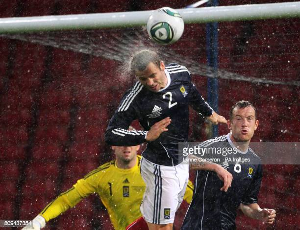 Scotland's Phil Bardsley heads the ball as rain falls during the International Friendly at Hampden Park Glasgow