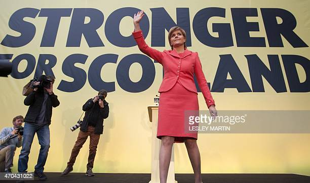 Scotland's proindependence First Minister Nicola Sturgeon waves at the launch of the Scottish National Party election manifesto in Edinburgh on April...