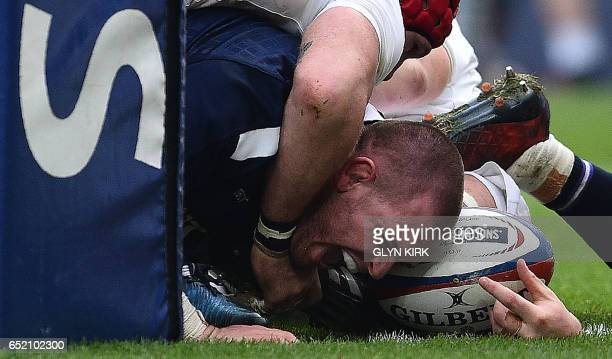 TOPSHOT Scotland's prop Gordon Reid scores his team's first try during the Six Nations international rugby union match between England and Scotland...