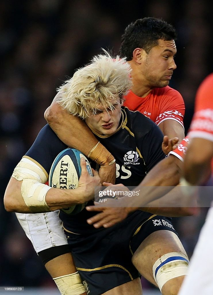 Scotland's Richie Gray (L) tries to break through the Tonga defence during the International rugby union test match between Scotland and Tonga at Pittodrie in Aberdeen on November 24, 2012. Tonga beat Scotland 21-15.