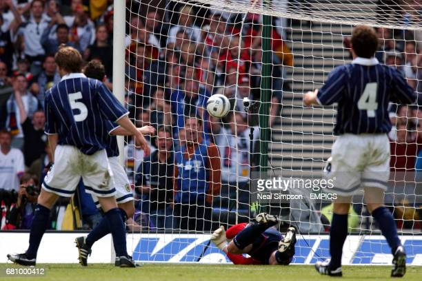 Scotland's Robert Douglas is beaten by a Fredi Bobic header to open the scoring for Germany