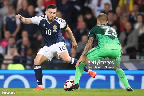 Scotland's Robert Snodgrass and Slovenia's Aljaz Struna battle for the ball during the World Cup Qualifying match at Hampden Park Glasgow