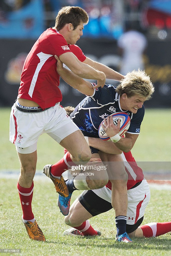 Scotland's Russell Weir vies with Wales defenders during Day 3 of the USA Sevens Las Vegas HSBC Sevens World Series Round 5 at Sam Boyd Stadium in Las Vegas, NV, February 10, 2013. AFP PHOTO/Jim WATSON