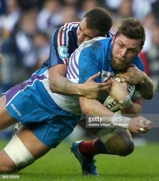 Scotland's Ryan Wilson is tackled by France's Damien Chouly during the RBS Six Nations match at Murrayfield Edinburgh