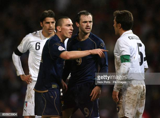 Scotland's Scott Brown gets involved as his teammate James McFadden and Italy's Fabio Cannavaro square up to each other