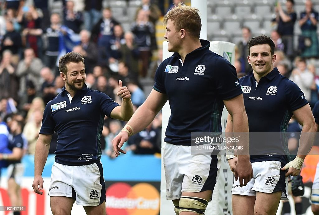 Scotland's scrum half and captain Greig Laidlaw, Scotland's number 8 David Denton and Scotland's centre <a gi-track='captionPersonalityLinkClicked' href=/galleries/search?phrase=Matt+Scott+-+Rugby+Union+Player&family=editorial&specificpeople=15066775 ng-click='$event.stopPropagation()'>Matt Scott</a> celebrate after winning a Pool B match of the 2015 Rugby World Cup between Scotland and Samoa at St James' Park in Newcastle-upon-Tyne, northeast England, on October 10, 2015.