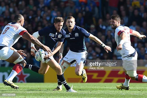 Scotland's scrum half and captain Henry Pyrgos runs with the ball next to Scotland's fly half Finn Russell US number 8 Samu Manoa and US flanker Al...