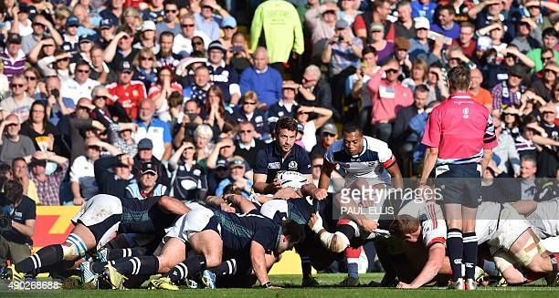 Scotland's scrum half Greig Laidlaw prepares to feed the ball into a scrum during a Pool B match of the 2015 Rugby World Cup between Scotland and USA...